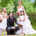 Bridal couple at wedding with bridesmaid children